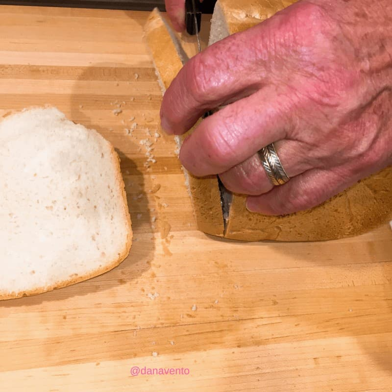 Cutting Beer Bread on a cutting board