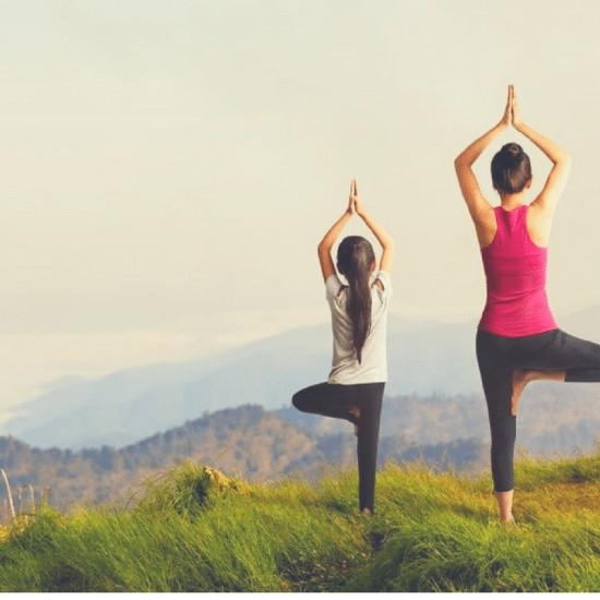 yoga people on mountain