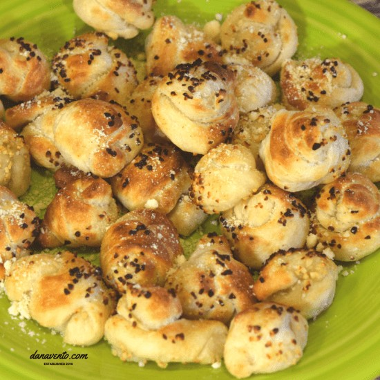 Parmesan Dusted Garlic Knots on a platter ready to eat