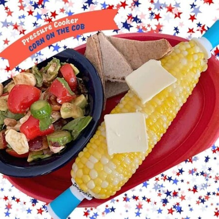 Awesome Pressure cooker corn on the cob on dish with salad