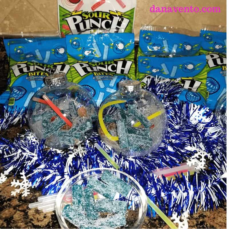 DIY glow in the dark candy filled ornament, ornament, candy filled, glow in the dark, candy inside, DIY, CANDY, sweet treat, treat yourself, holiday diy, crafting, food, parties, New Year's Eve, Celebrations, Holiday Parties, partying, glow, glow in the dark, glow sticks, Sour Punch® Bites®, Blue Assorted Bites® , Raging Reds Bites®, food and decor, decor for parties, fast decor, easy diy, holiday fancy, holiday light up decor, no batteries required, fun with food, creative food presentation, glow in the dark, ornaments that glow in the dark, glow in the dark food ornaments, party, parties, food for parties, sweet treats for parties, sweet treats for your, Sour Punch, Sour Punch Red, Sweet and Sour treats, chewy, gummy like