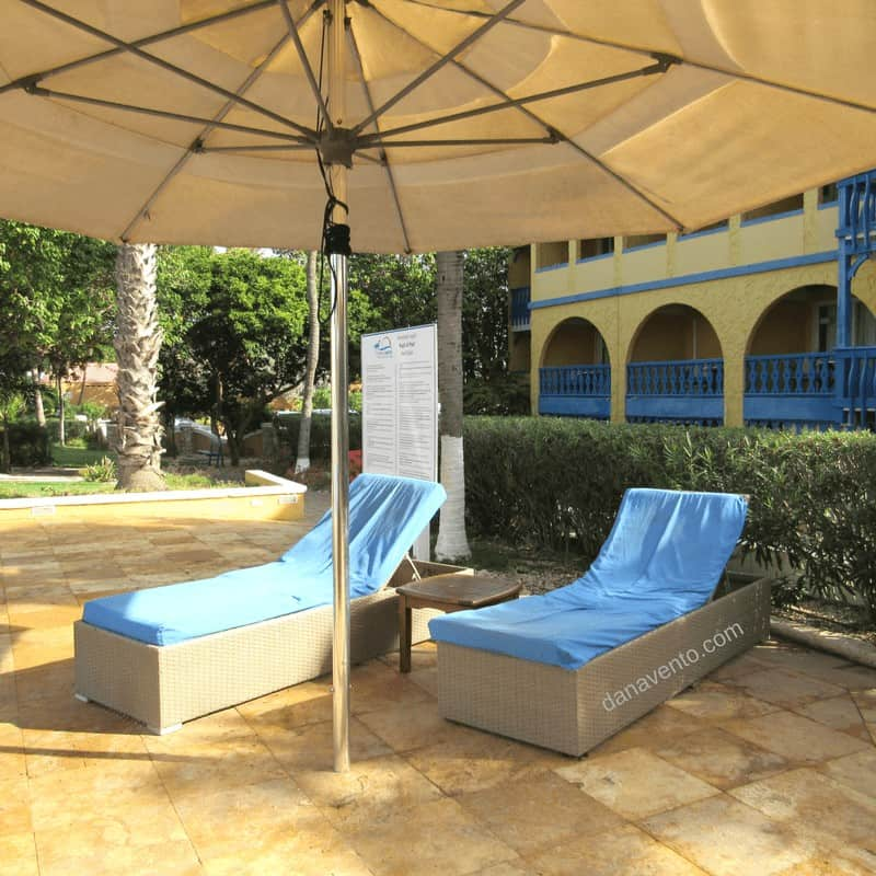 Best Bonaire Resort - poolside with umbrellas and chaise loungers