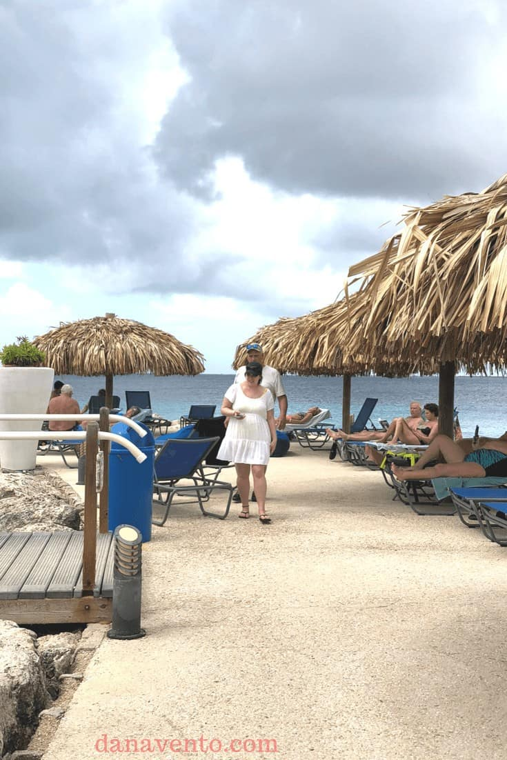 Pier with palapas, alcohol and people at best Bonaire resort