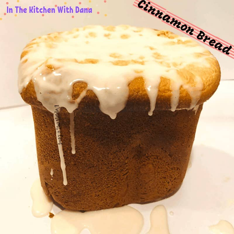 easy cinnamon bread loaf with icing dripping down side up close