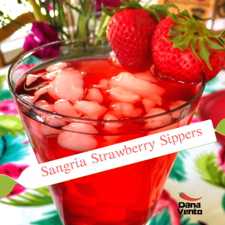 Sangria sipper in a glass with 2 strawberries on it