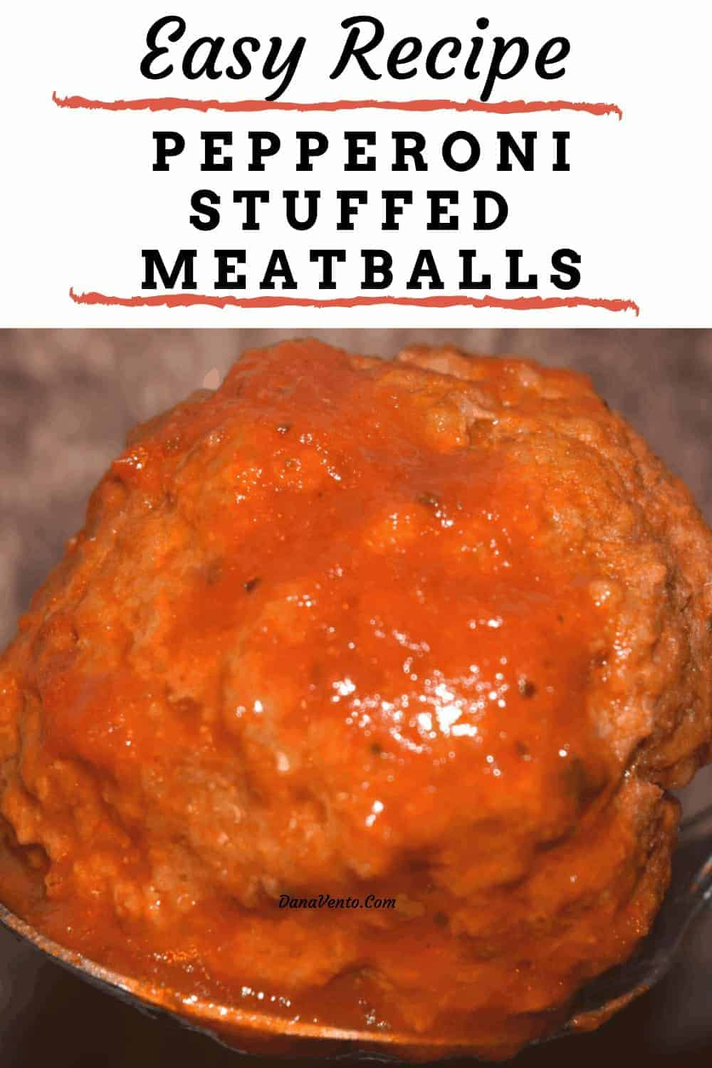 Pepperoni Stuffed Meatball on a spoon very close to see