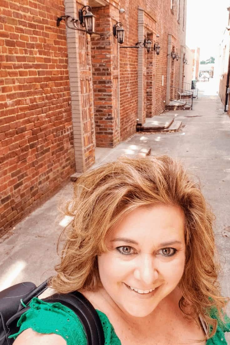 me goofing around in an alleyway in Conway's historic district while in Myrtle Beach
