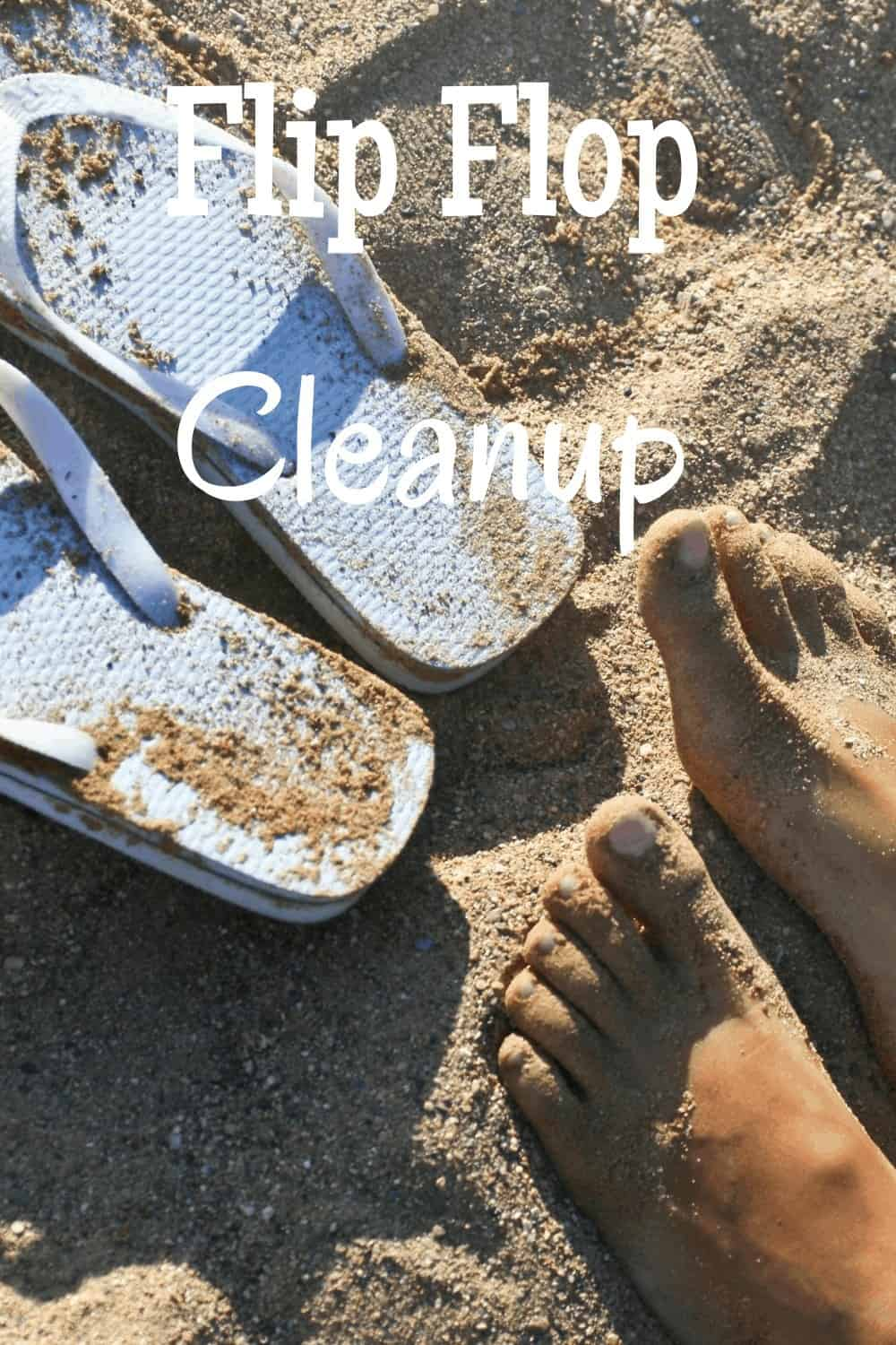 feet in sand and flip flops next to them