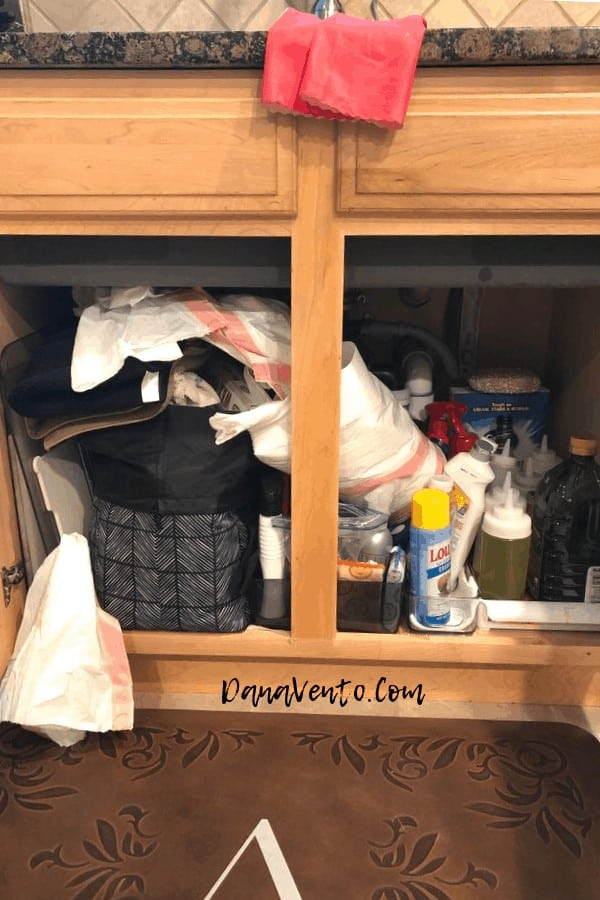 7 Smart Ways to Organize Under the Kitchen Sink , cleaning up, tossing out, no hammer require, measure, trash, cleaning up, cleaning out, garbage bags, wiping up, contact paper, rolls of contact paper, 3M strip, tip out drawer, DIY, DIY With Dana, Easy Kitchen DIY, Fast DIY, Hanging, baskets, organize, organizer, things to corral, how to, what to clean, how to clean it, why to clean it, differences, update, labeling, before and after, sponges, cleaners, dishwasher detergent, scrubbers, underneath, contain the mess, save money, simple DIY Ideas for under the kitchen sink