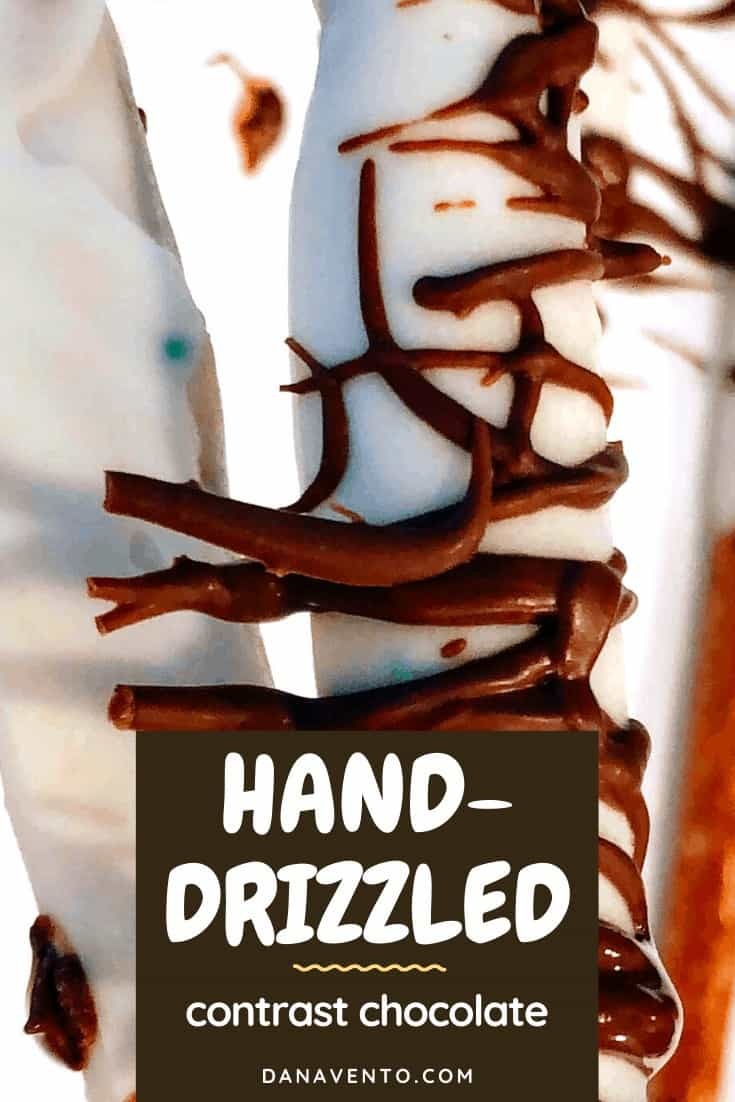 Easy Hand-Drizzled Chocolate Covered Pretzel rods white chocolate, dark chocolate, milk chocolate, dipping, dunking, tall glass, video recipe, how-torecipe, holiday recipe, chocolate covered pretzels, chocoatel covered, chocolate dipping, dipping in glass, video recipe, recipe video, Christmas recipe, Party Recipe, platters, foods, snacks, dessert, easy to make, easy to recreate, pretzel sticks, pretzel rods, striping, dries fast
