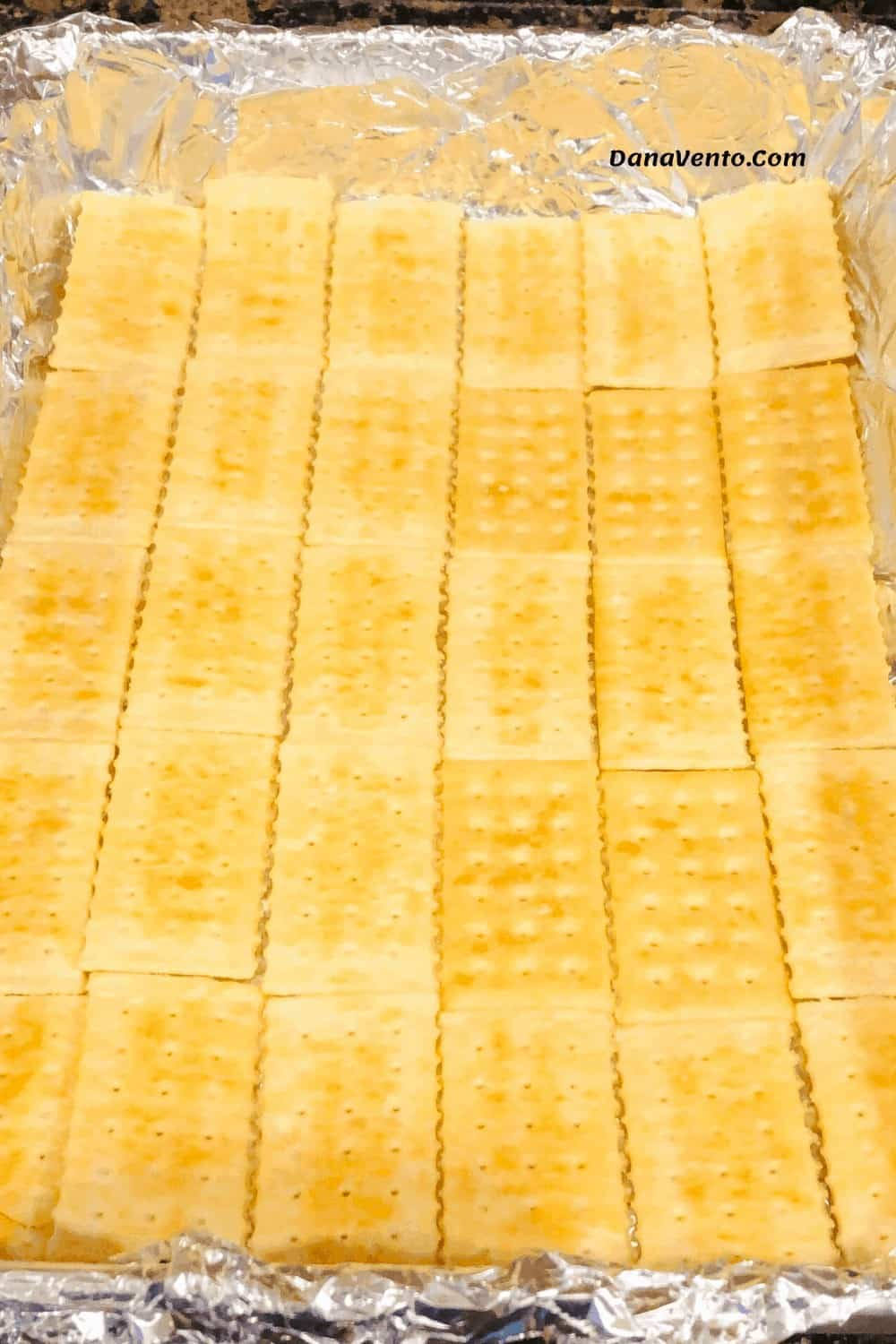 crackers in pan stacked for covering