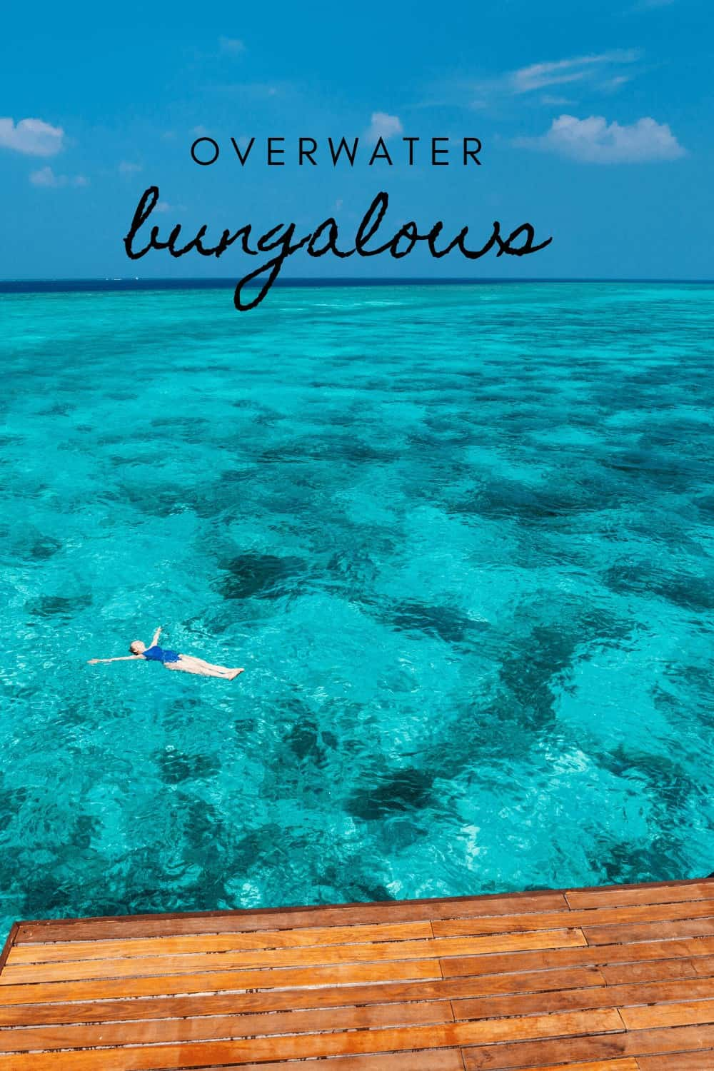 swimming by a private overwater bungalow