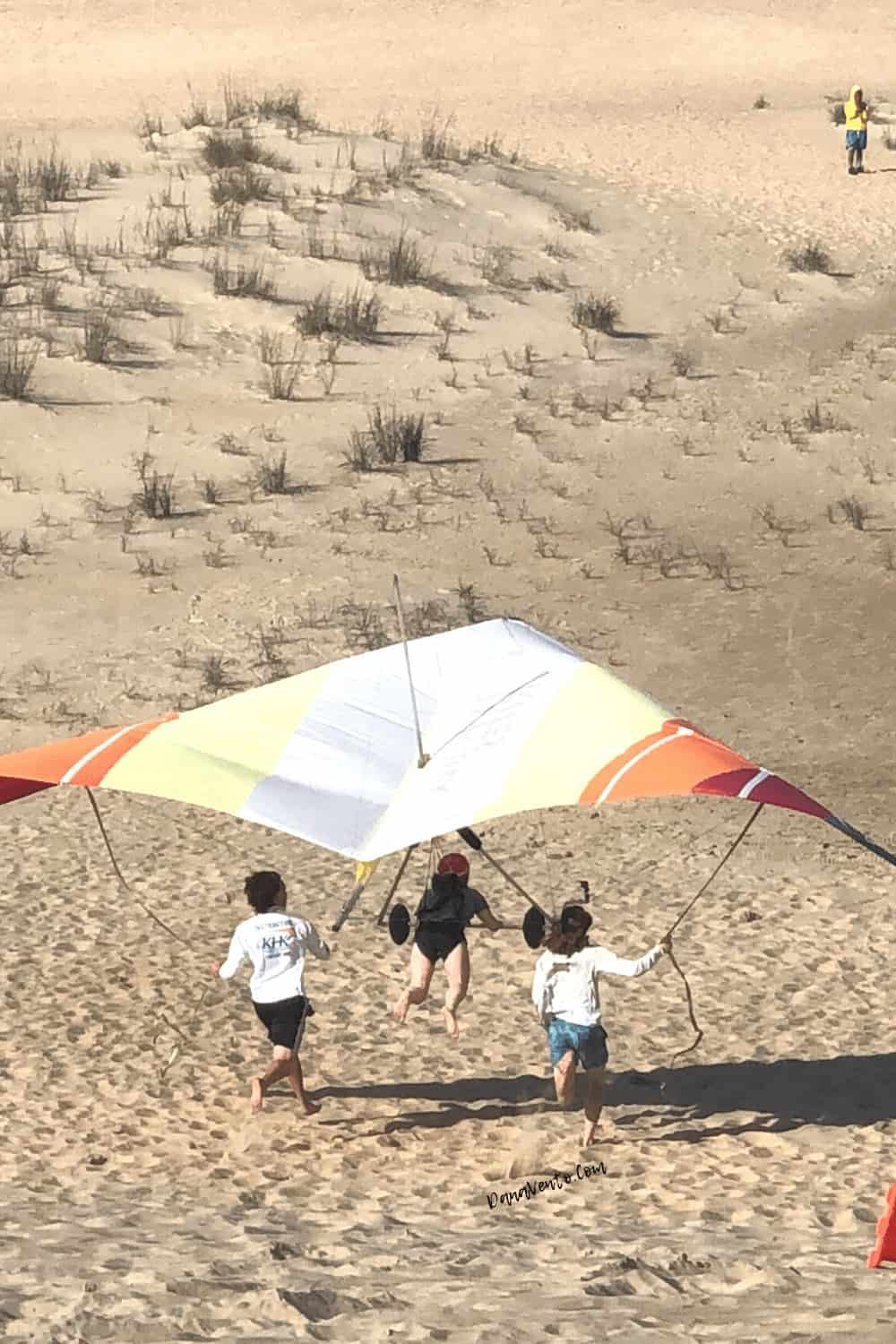 Hang Glider In Low of Dune with spectators