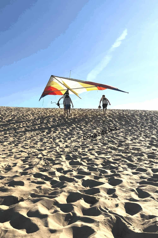 climbing Sand Dune in Jockey Ridge State Park