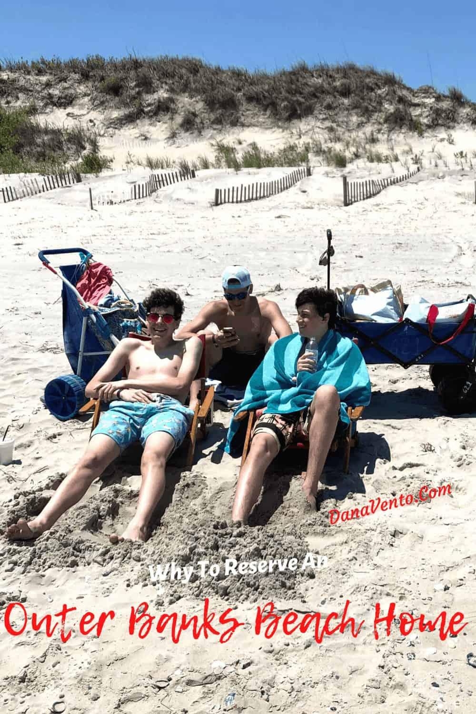 boys on beach chairs in Corolla Beach