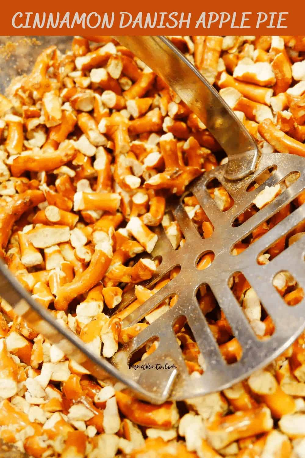 Pretzels being crumbled for Cinnamon Danish Apple PIe