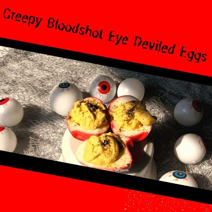 Creepy Bloodshot Deviled Egg Eyeson a table with other eyeball decor