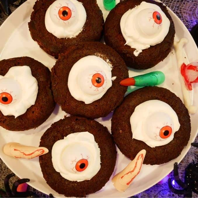Halloween Eyeball Brookie sitting on a tray with fingers