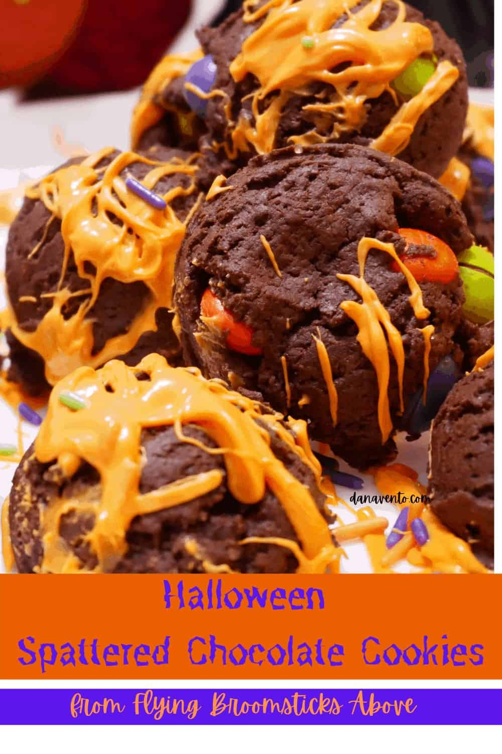 Chocolate witch cookie bombs up close with orange chocolate spatter.