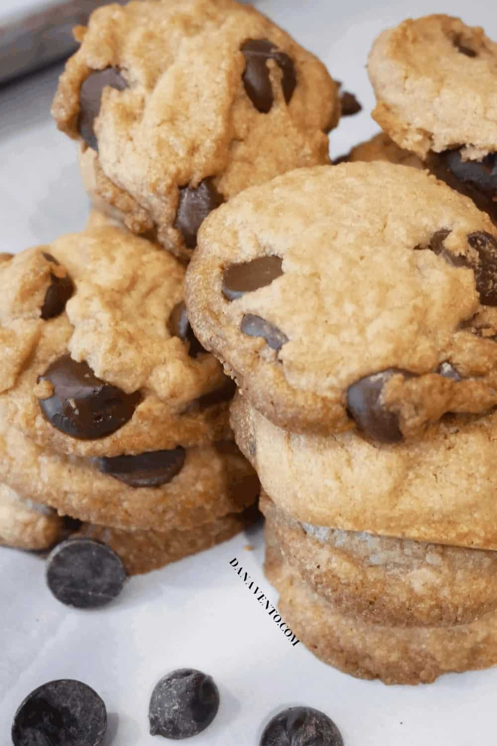 Chocolate chip cookies piled atop each other