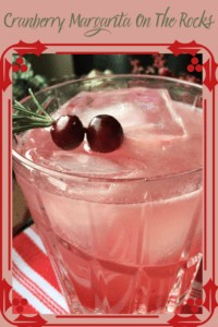 2 cranberries on Rosemary sprig