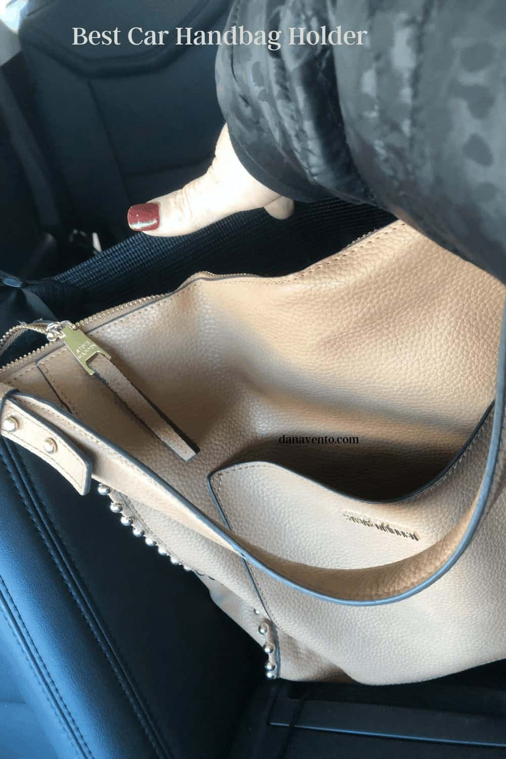 handbag and holder with my hand going in bag