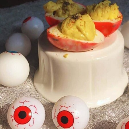 cropped Blooshot deviled egg eyes done and on Halloween table