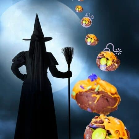 cropped chocolate witch cookie bombs with witch watching in distance large cookies