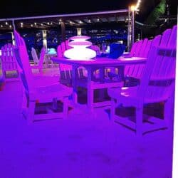 enchanted Aruba beachfront dining tables waiting for you